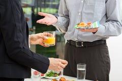 Discussion d'affaires avec le petit déjeuner Photographie stock