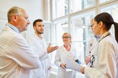 Discussion between doctors and nurses. And planning therapy as group stock images