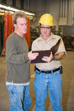 Discussion on Factory Floor Stock Photo