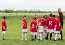 Discussion of the kid soccer team stock photo