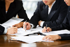 Discussion in office. Discussion between businesspeople in office Royalty Free Stock Image