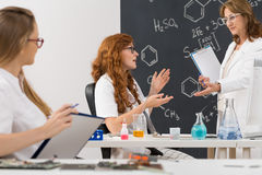 Discussion with professor in a classroom royalty free stock images