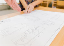 Discussion about technical drawing Royalty Free Stock Image