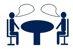 Discussion Between Two Business men at the Round Table. You can fill your desired text into the bubbles Stock Image