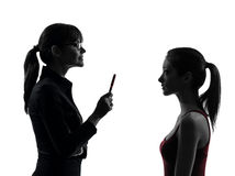 Discussione della ragazza dell'adolescente della madre della donna dell'insegnante nel uet della siluetta Fotografia Stock Libera da Diritti