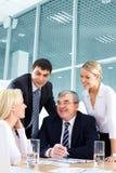 Discutindo a estratégia bem sucedida Imagem de Stock