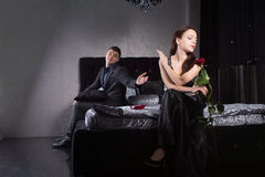Disdainful woman ignoring her husband or boyfriend Stock Image