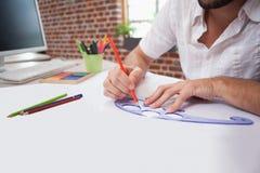 Diseñador que dibuja la manera pasada de moda Fotografía de archivo