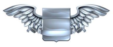 Diseño con alas plata de la voluta del escudo Foto de archivo libre de regalías