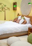 Diseño de cama en tema del resorte Foto de archivo libre de regalías