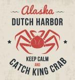 Diseño de la camiseta de Alaska, impresión, tipografía, etiqueta con el cangrejo de rey Fotos de archivo