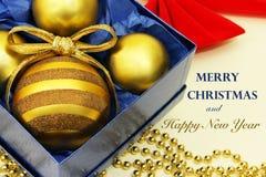 Diseño de la Navidad con saludos del día de fiesta Foto de archivo libre de regalías