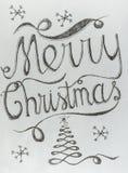 Diseño de letras dibujado mano de la Feliz Navidad Foto de archivo libre de regalías