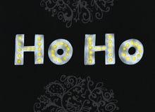 Diseño de letras moderno elegante del cepillo de Ho Ho Gold que brilla y de la plata en un ejemplo negro del rastr del fondo dele Imagen de archivo