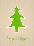 Diseño de papel rasgado de la tarjeta de Navidad en verde Foto de archivo libre de regalías