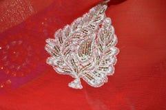 Diseño de plata en tela roja Fotografía de archivo libre de regalías