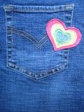 Diseño del corazón en los pantalones vaqueros Imagenes de archivo