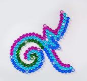 diseño del número nueve con las piedras preciosas coloridas Fotografía de archivo