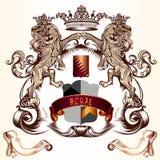 Diseño heráldico con los leones que sostienen el escudo y las coronas Foto de archivo
