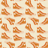 Diseño inconsútil del inconformista del fondo de los gumshoes anaranjados Imagen de archivo libre de regalías