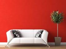 Diseño interior de sofá blanco en la pared roja Imágenes de archivo libres de regalías