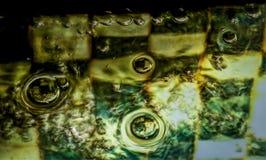 Diseños abstractos metálicos de la fuente de la burbuja imagenes de archivo