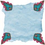 Diseños de Etoffe de la turquesa en el papel rasgado Foto de archivo