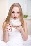 Disease. Young woman taking medicine in bedroom at home Royalty Free Stock Photo