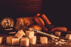 Disease - diabetes. Sugar, syringe for injection, harmful food Stock Images