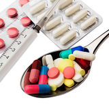 Disease. A lot of pills into spoon Royalty Free Stock Photo