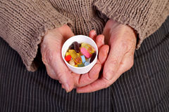 Disease prevention. Close up of an elderly hand holding a box with pills Stock Photography
