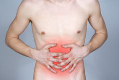 Disease of the stomach the guy Royalty Free Stock Images