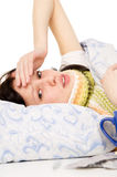 The diseased beautiful girl lying in bed, aching head Stock Photo