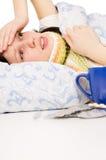 Diseased Beautiful Girl Lying In Bed Stock Photography
