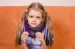 Diseased five year girl with certain subject in hands of Stock Images