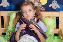 Diseased five year old girl lying in bed Royalty Free Stock Photography