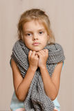 Diseased five year old girl wrapped in a scarf Stock Images