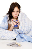 The diseased girl lying on the bed, and drink medicine Royalty Free Stock Photo