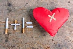 Diseased heart. Antismoking background. Stop smoking Stock Photos