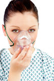 Diseased young woman with an oxygen mask Stock Images