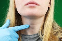 The girl on examination at the doctor. Thyroid royalty free stock image