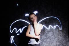 Disegni con le ali leggere del demone o di angelo fotografia stock libera da diritti