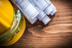 Disegni di costruzione degli occhiali e casco protettivi della costruzione Fotografia Stock Libera da Diritti