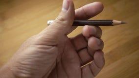 Disegni a matita cadere nei concetti di idea della mano al rallentatore - stock footage