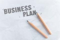 Disegni a matita il business plan di parola di tiraggio su Libro Bianco con lo spazio della copia immagine stock