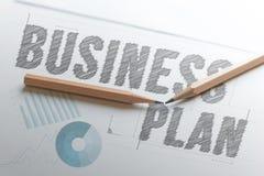 Disegni a matita il business plan di parola di tiraggio su Libro Bianco con lo spazio della copia fotografia stock libera da diritti
