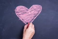 Disegno del cuore del gesso immagini stock libere da diritti