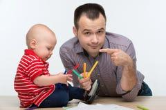 Disegno del figlio del bambino e del padre Fotografie Stock