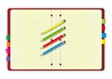 Disegno del taccuino con le matite fotografie stock