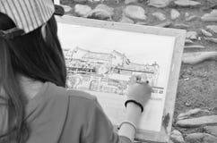 Disegno del villaggio di Hongcun con l'artista Fotografia Stock